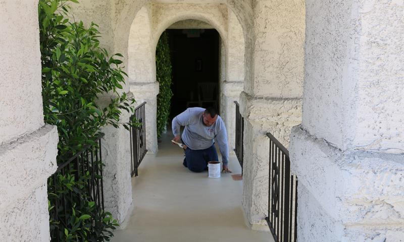 Man working on walkway