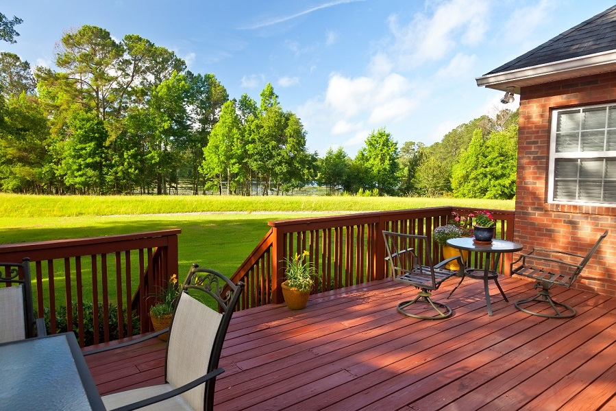 large wooden deck and chairs and perfect landscape view