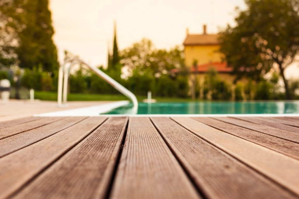 the planking of a swimming pool with shallow depth of field
