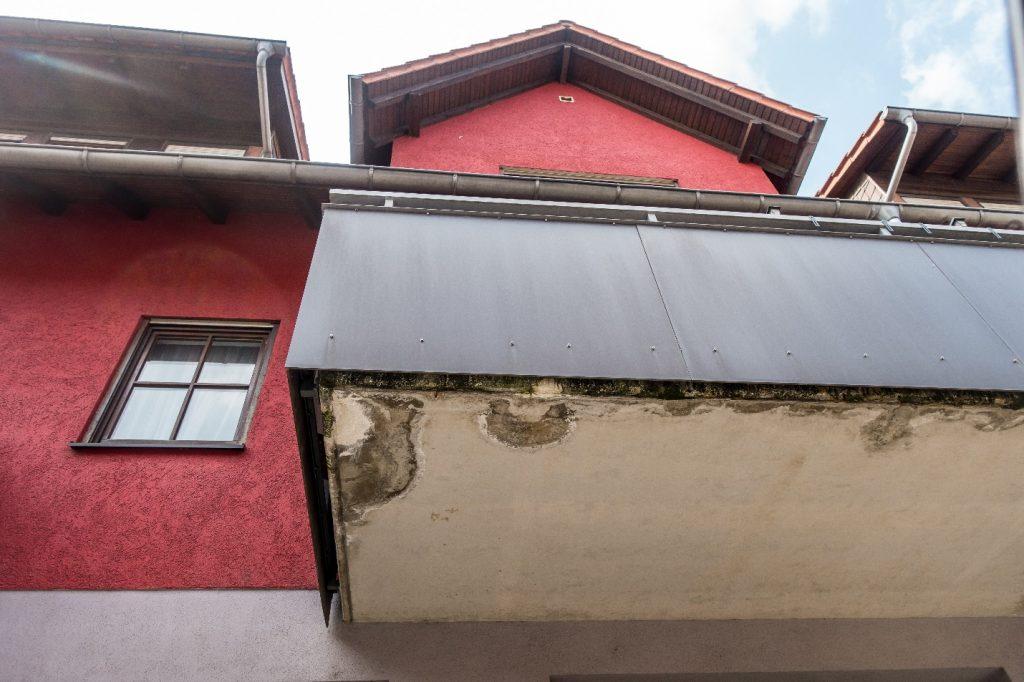 water damage underneath balcony