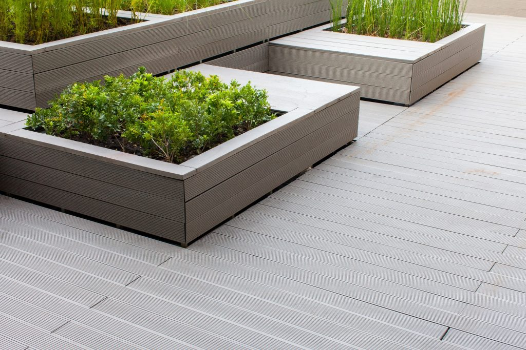 Outdoor planter with green planting on the building